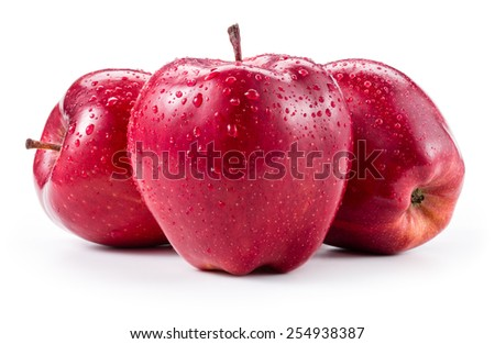 Three fresh red apples with drops isolated on white - stock photo