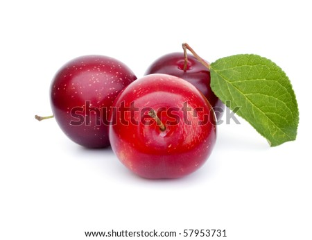 Three fresh ripe plums with leaf - stock photo