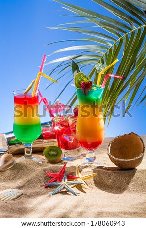 Three Fresh tropical cocktail on beautiful sunny beach - stock photo