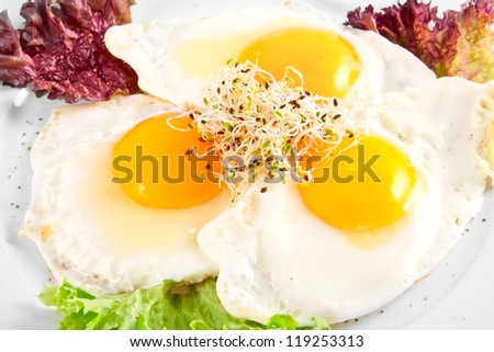 Three fried eggs - stock photo