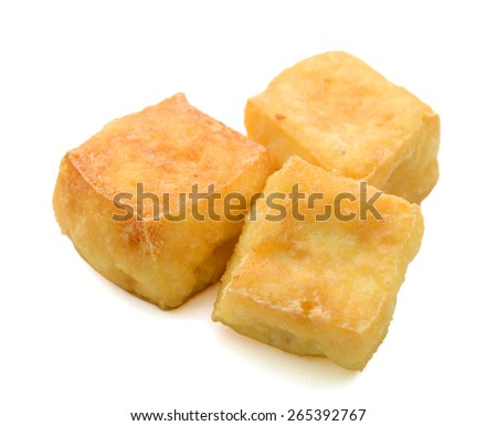 three fried square tofu on white background  - stock photo