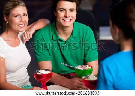 Three friends enjoying day out in a restaurant - stock photo