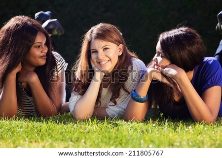 Three Friends Relaxing at the Park - stock photo
