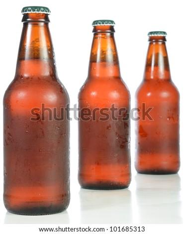 Three full beer bottles isolated on white. - stock photo