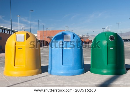Three Garbage containers for separate types of trash - stock photo