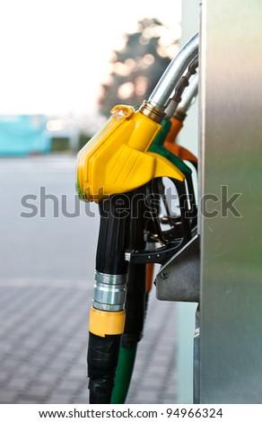 Three gas pump nozzles - stock photo