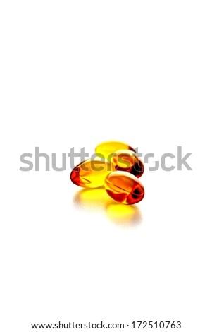 Three gel capsules isolated. - stock photo