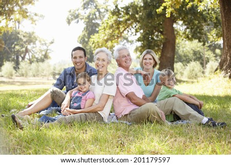Three generation family in the country - stock photo