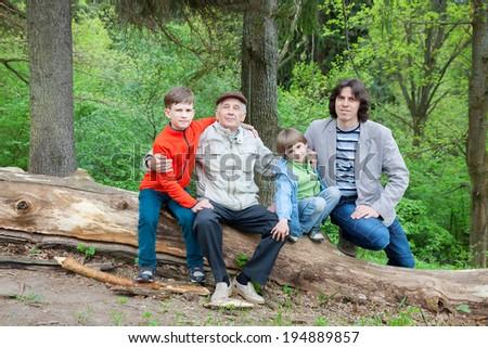 three generations of men in spring park - stock photo
