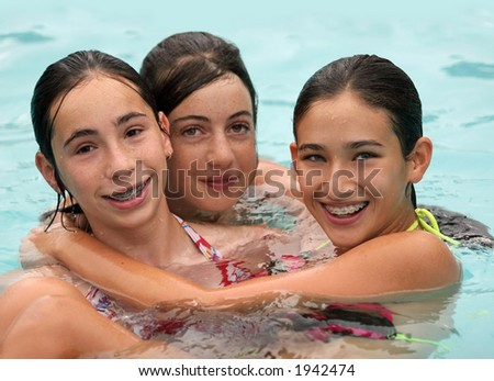 Three girlfriends in a swimming pool - stock photo