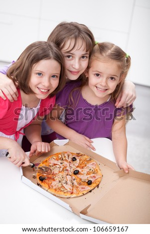 Three girlfriends sharing a pizza - childhood friendship - stock photo