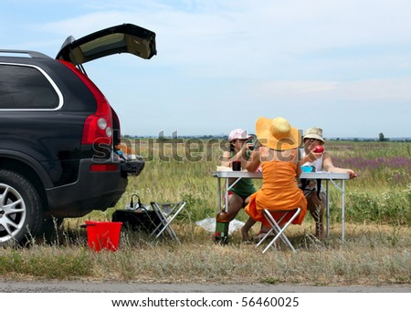 three girls have dinner at road - stock photo