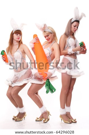 Three girls in suits of a hare with a different carrot - stock photo