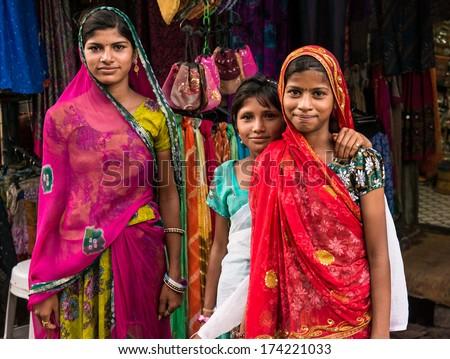 Three girls in the streets of Pushkar, India. Pushkar, India circa May 2013. - stock photo