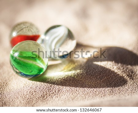 Three glass balls on cloth background. - stock photo