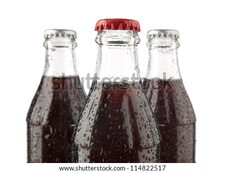 three glass bottles with cola on a white background , with no labels. Isolated on white background. - stock photo