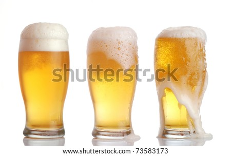 Three glasses of beer with froth - stock photo