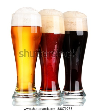 three glasses with different beers isolated on white - stock photo