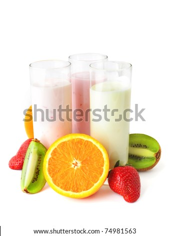 Three glasses with yogurts surrounded by fresh fruits. Healthy eating. - stock photo