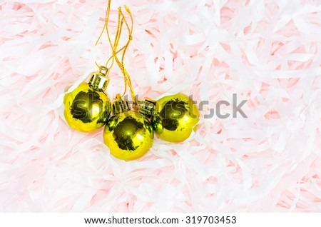 Three gold balls for the Christmas tree on christmas decorations. tinsel - stock photo