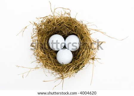 three golf balls in a nest - stock photo