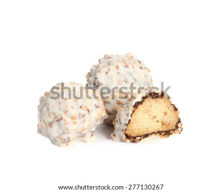 Three gourmet assorted white truffles hand made by chocolatier on white background. One truffle cut in half - stock photo