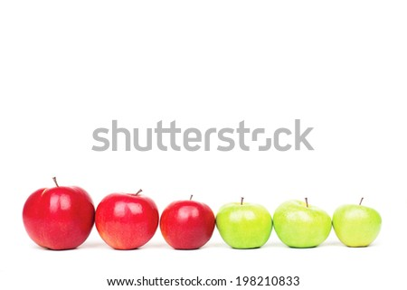 Three green apples follow to three red apples, on isolated background - stock photo