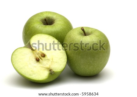 three green apples on white background - stock photo