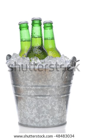 Three Green Beer Bottles in Ice Bucket with Condensation isolated on white vertical composition with reflection - stock photo