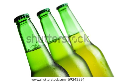 three green beer bottles isolated over white background - stock photo