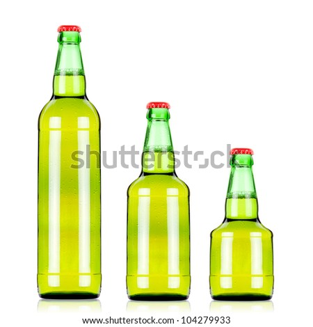 three  green beers bottles of different size over white background/green beer bottles - stock photo