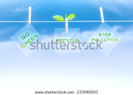 Three green road sign hanging on blue sky background, go green, recycling of garbage, stop pollution, save environment concept - stock photo