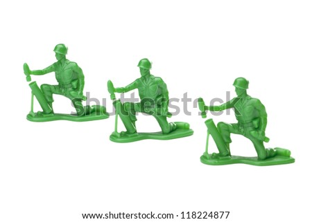 Three green soldiers over the white background - stock photo