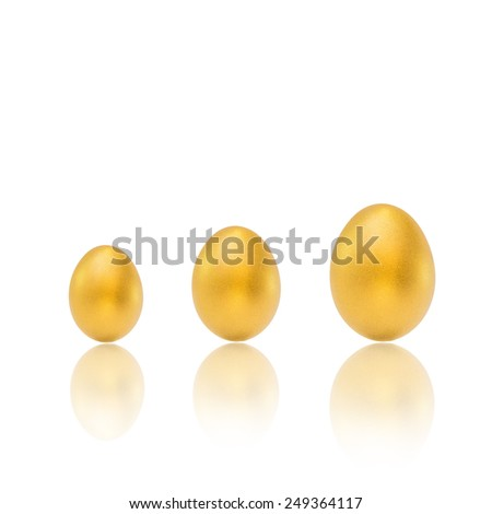 Three growing golden eggs with reflections: A golden egg opportunity concept of a chance to make a fortune and to be rich - stock photo