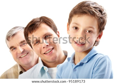 Three guys presenting three generations of the family looking at camera and smiling - stock photo