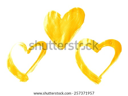Three handmade heart shapes drawn with the oil paint brush strokes, isolated over the white background - stock photo