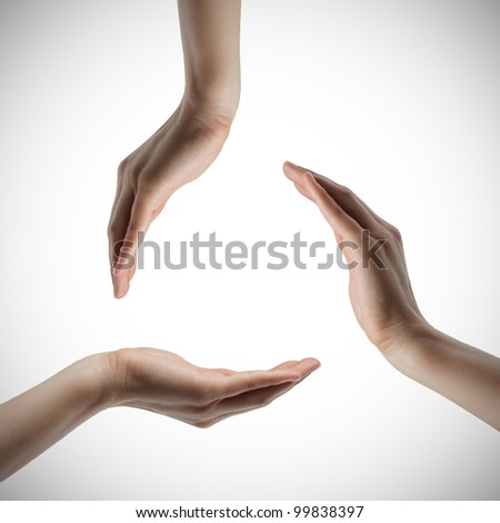 three hands keeping a circle. isolated on white background - stock photo