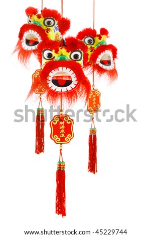 Three hanging Chinese new year lion head ornaments on white background - stock photo