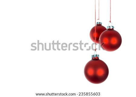 Three hanging Christmas balls over a white background - stock photo