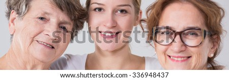 Three happy family women standing together - stock photo
