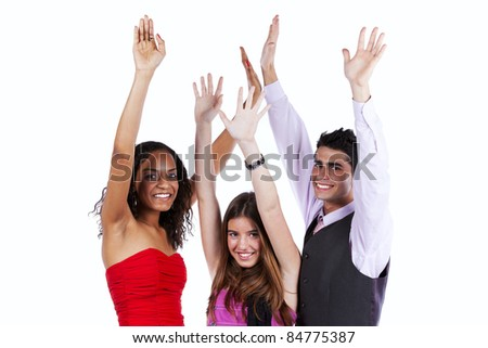 Three happy friends with arms raised (isolated on white) - stock photo