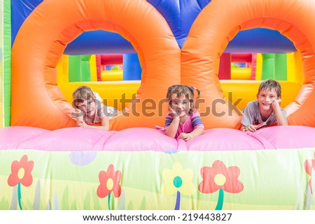 three happy kids having fun on playground - stock photo