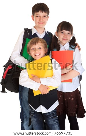 Three happy kids ready to go to school. - stock photo