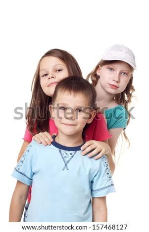 three happy little children standing in studio - stock photo