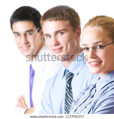 Three happy smiling successful business people, isolated over white background - stock photo
