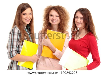 Three happy students standing together with fun, while smiling and looking at camera isolated on white background - stock photo