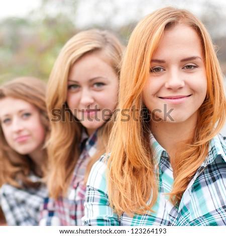 Three happy teenage girls friends - stock photo