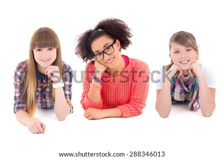 three happy teenage girls lying isolated on white background - stock photo
