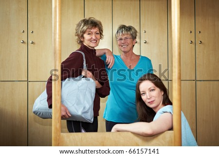 Three happy woman smiling in changing room - stock photo