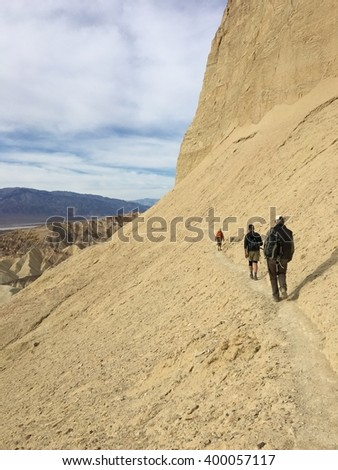Three Hikers, Death Valley - stock photo